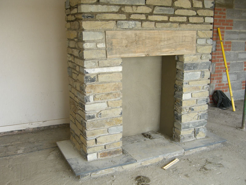 New fireplace being built by Dyfi Renovations Ltd