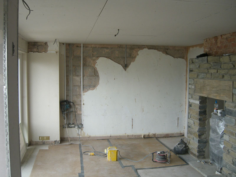 Removing old render by Dyfi Renovations Ltd