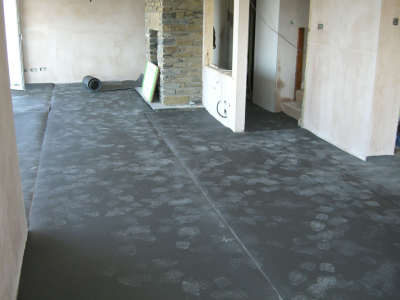 Heated floor being installed by Dyfi Renovations Ltd