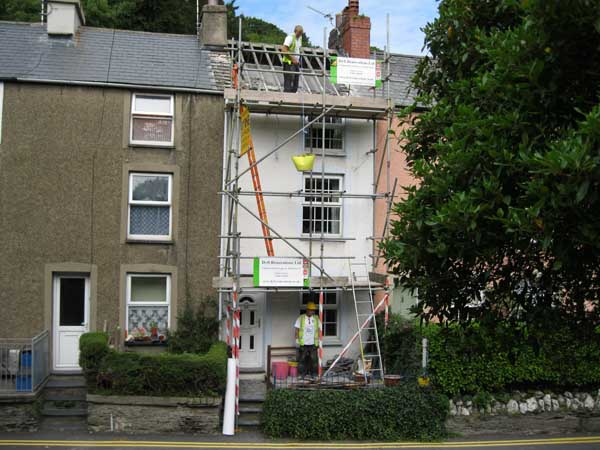 Work on replacing roof on terrace house